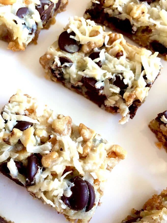 Million Calorie Bars! A one pan bar recipe with a savory graham cracker crust topped with chocolate, butterscotch, coconut and your favorite nuts. All bound with sweetened condensed milk to provide the perfect one bite bar!