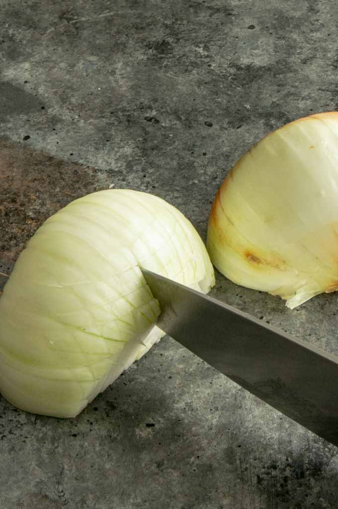 "Step 2 in cutting onion. 1/4"" apart side to side"
