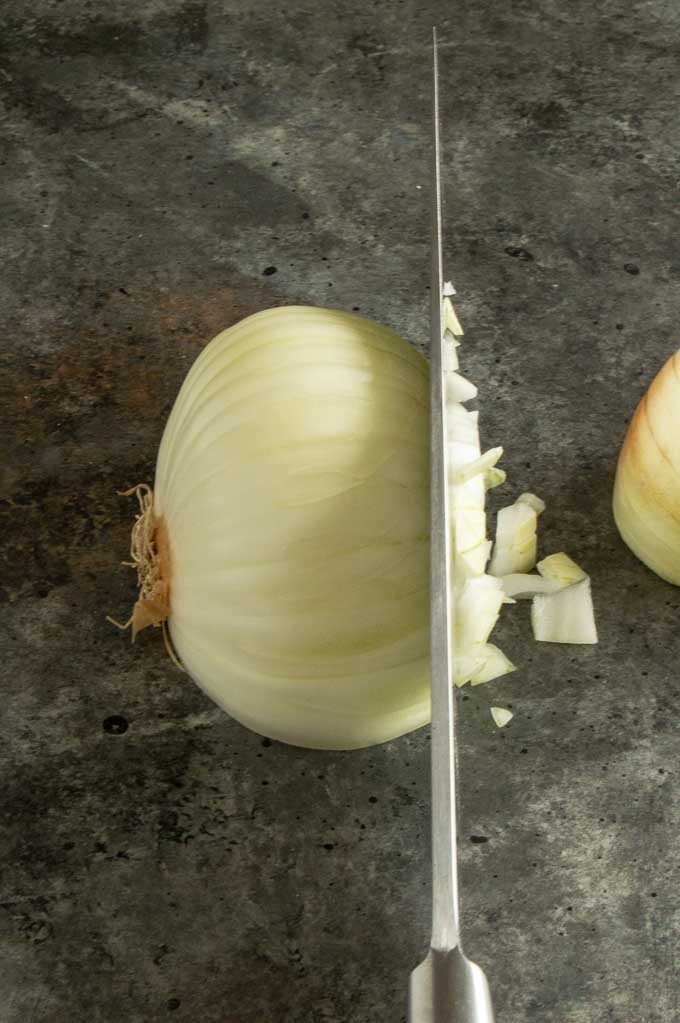 Cutting the last onion step into small cubes across both cuts.