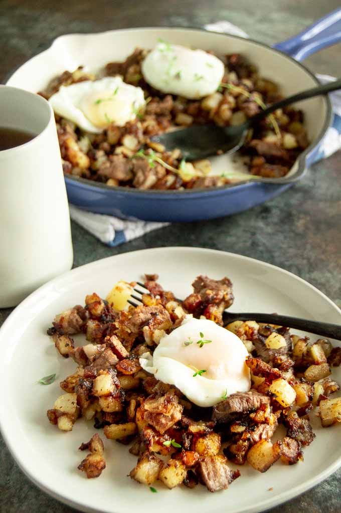 Serving table of leftover prime rib hash.