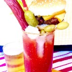 This Loaded Bloody Mary Cocktail is a full meal! Spicy Horseradish compliments the tangy tomato base and its topped with all the foods you want to eat when drinking a Bloody Mary, a burger, beef stick, olives, chunks of cheese and a Celery Stalk! Perfect for a brunch or watching a game!