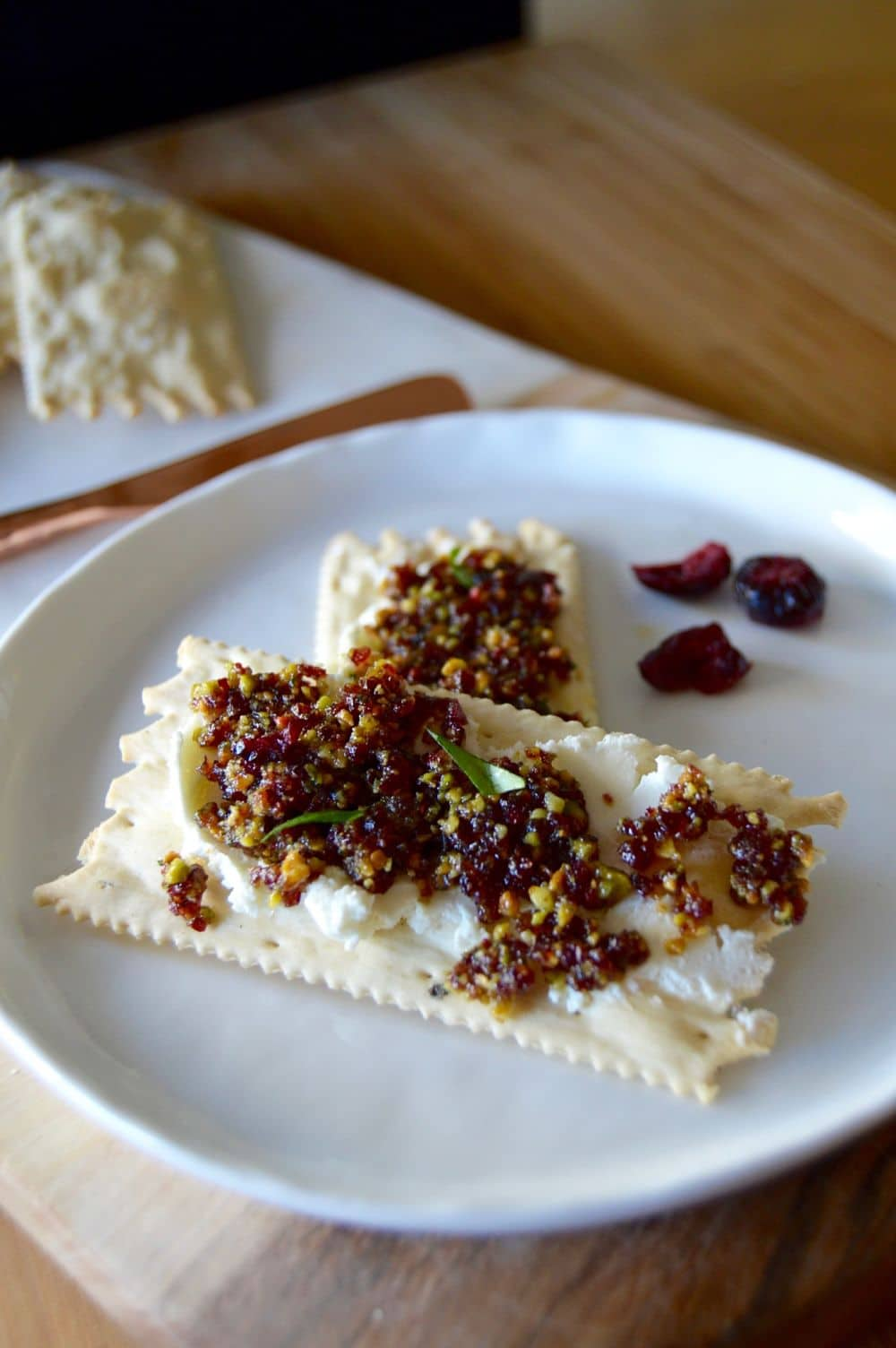 Looking for a festive spread for the holidays? This Cranberry Pistachio spread is not only easy peasy, but bursting with flavor and just the thing for a simple appetizer. Spread it on your favorite cracker and it's a mouthful of deliciousness.