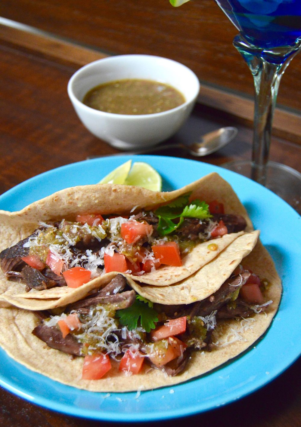 Simple Short Rib tacos with homemade tomatillo salsa out of the leftovers from the day before in less than 30 minutes! Easy recipe that's fast and delicious! A complete win/win! www.westviamidwest.com