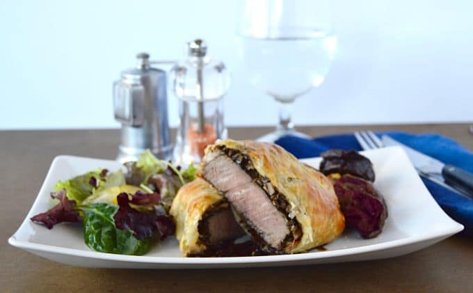 Simple Beef Wellington looks impressive. It's a flaky puff pastry crust wrapped around a juicy beef filet that also is perfectly slathered with mushrooms and prosciutto. Top it off with an easy-peasy stock full of flavor red wine sauce…. That special someone will definitely love you for this recipe.