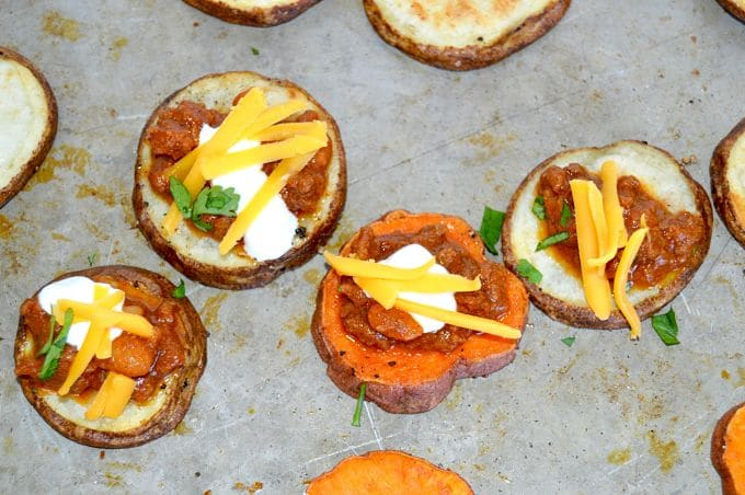 Small, one-bite appetizers for a small get together. This recipe for Smokey Chili Potato Bites has chili topped with cheese served over a crisp baked potato wedge with a cool creamy Chobani yogurt dollop.