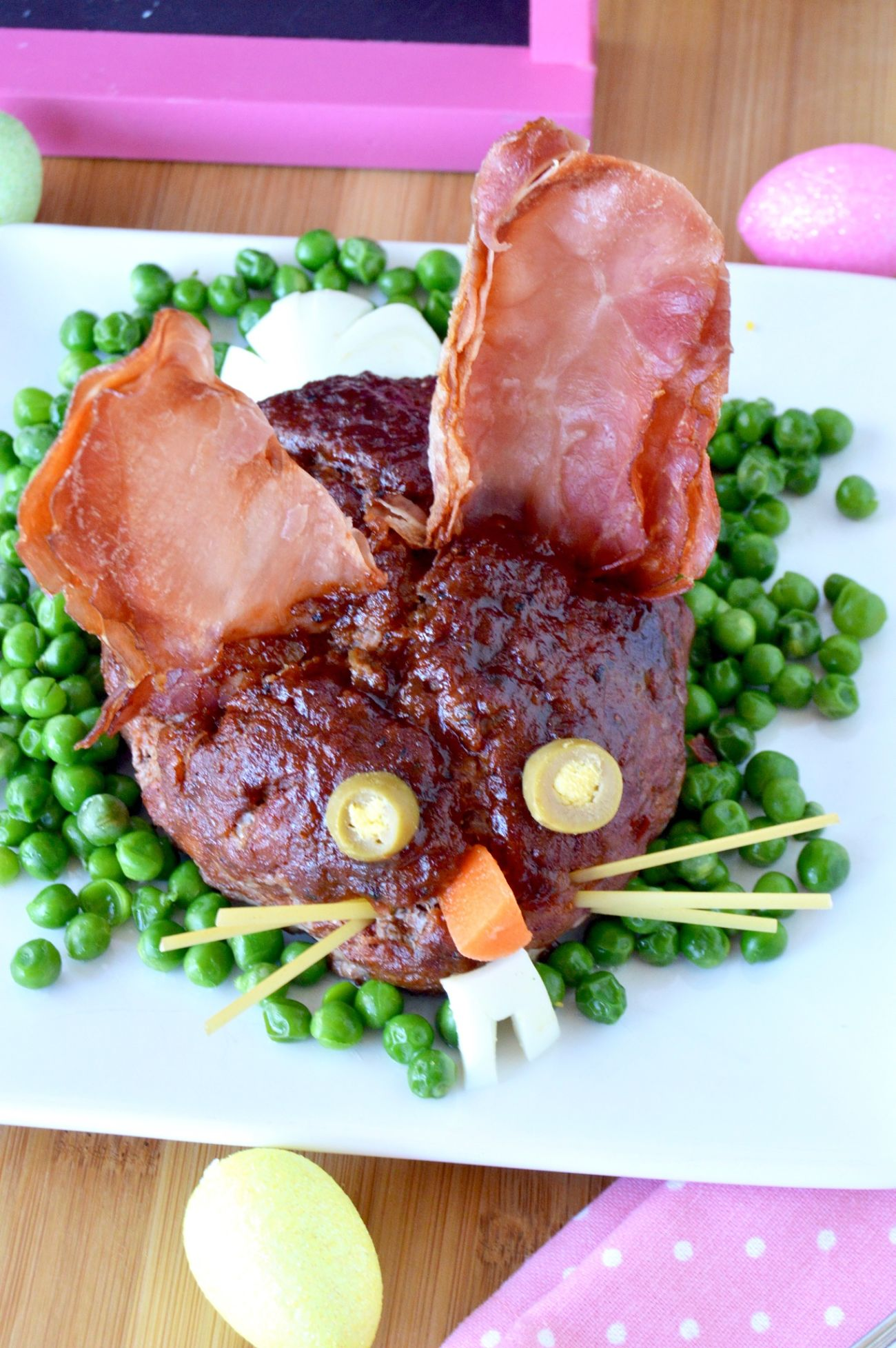meatloaf in the shape of a bunny on a white plate