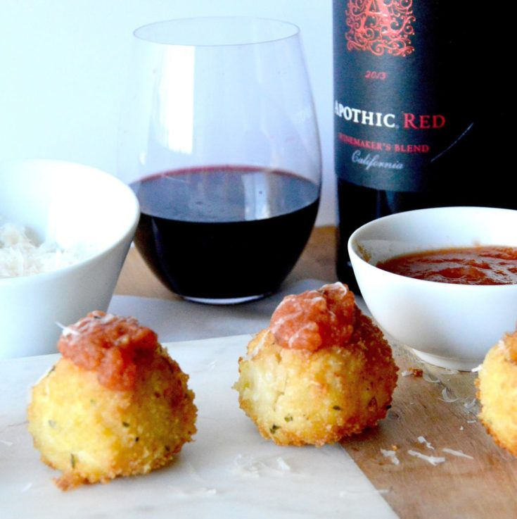 Gruyere Salami Risotto Balls (Arancini): An easy appetizer to make from leftover risotto. These Arancini balls are filled with a melty, stretchy Gruyere cheese and a spicy salami. Those are surrounded by risotto that is rolled in panko and fried for a crunchy bite of deliciousness!Gruyere Salami Risotto Balls (Arancini): An easy appetizer to make from leftover risotto these Arancini balls are filled with a melty, stretchy Gruyere cheese and a spicy and salami. Those are surrounded by risotto that is rolled in panko and fried for a crunchy bite of deliciousness!
