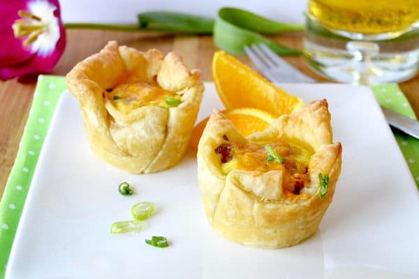 These Loaded breakfast cups are packed full of flavor. They include Sausage, cheese, eggs and hash browns. All in one puff pastry shell. Serve them for breakfast and save any leftovers for snacks!