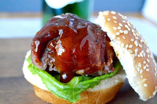 This BBQ Bacon Meatball Slider recipe is sure to be a hit! Juicy meatballs, wrapped in bacon brushed with BBQ sauce are the stars of this delicious slider!