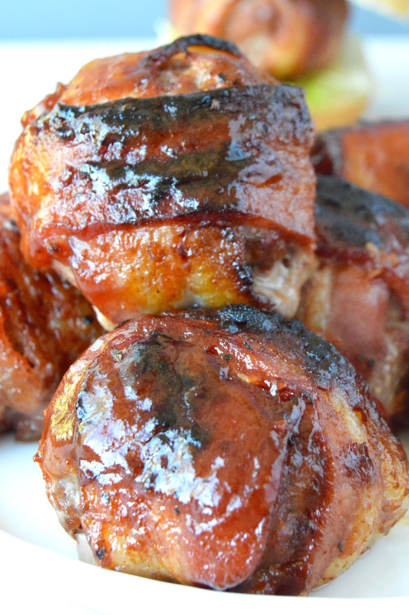 This BBQ Bacon Meatball Slider recipe is sure to he a hit! Juicy meatballs, wrapped in bacon brushed with BBQ sauce are the stars of this delicious slider!