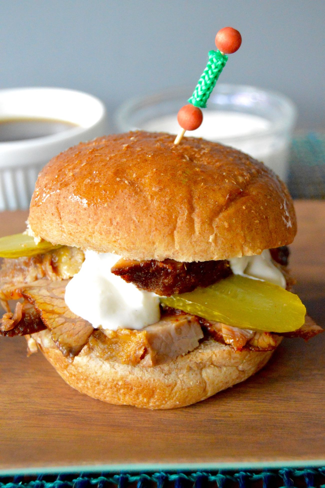 Spicy Beef Brisket Sliders are super tender, juicy and jam packed with flavor. Only 10 minutes to prep, then the rest is leave alone cooking time! Great for big parties where you need single serving foods!