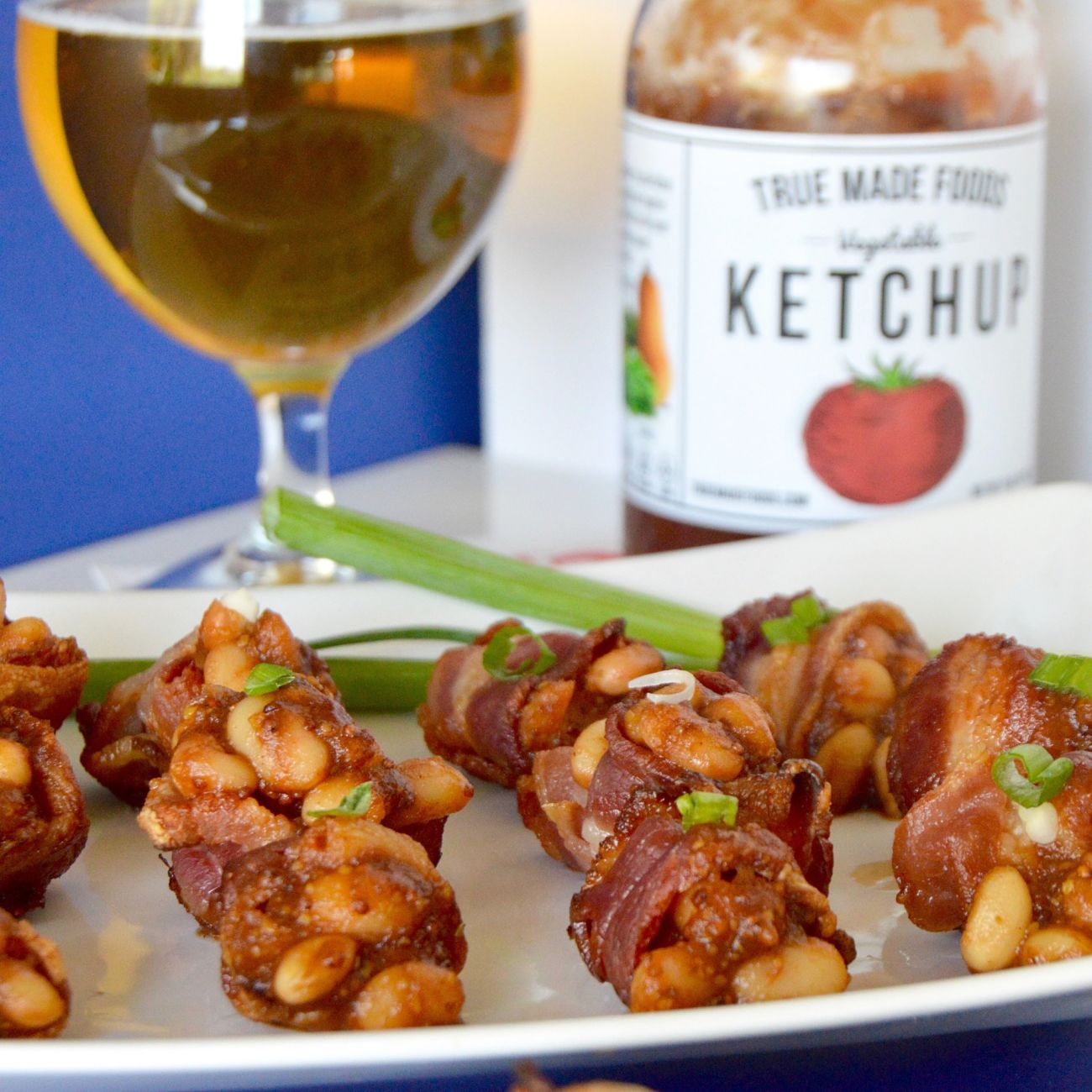 Baked Bean Bacon Cups are ideal for a big BBQ! Bite sized baked beans packed full of flavor served in individual servings of bacon cups! For those times you want to try everything, but don't want to be so full afterwards you can't move!