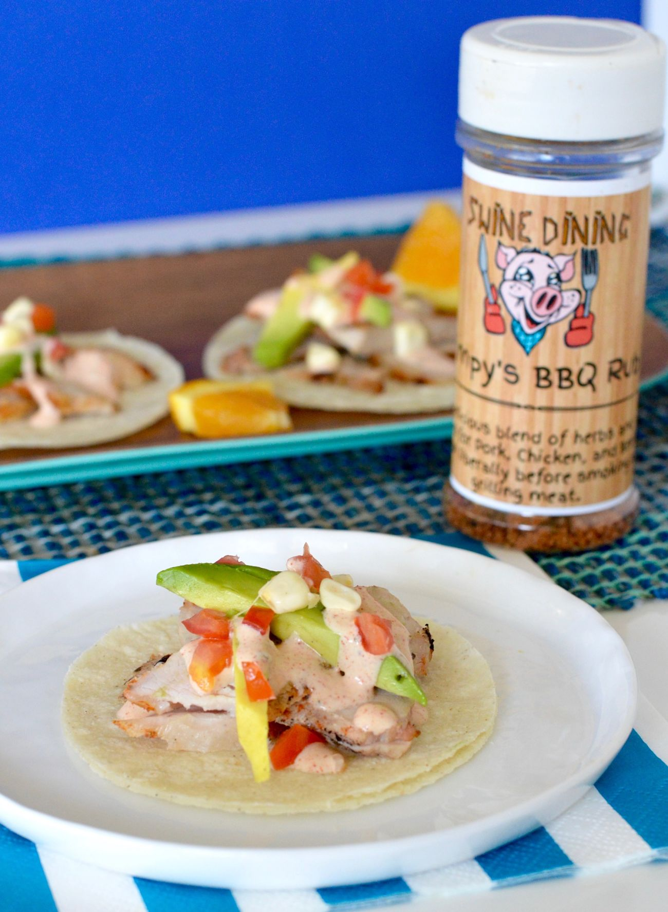 Grilled Pork tacos with Wimpy BBQ Rub Crema are tender, easy, have a hint of smoky, sweet and citrus to give you an easy weeknight dinner or small bite sized appetizers for a quick get together!