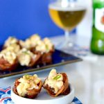 Show stopping bites that your guests will love! These Bacon Mac n Cheese Cups are perfect to make for the big game! Each bite full of creamy mac n cheese but served in a crispy, salty bacon cup!