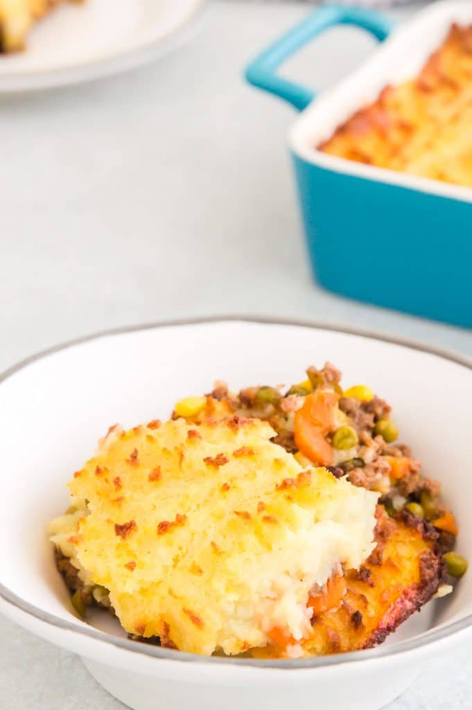 scooped serving of cottage pie in a white bowl