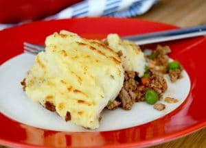 Cook once, eat twice. Gouda Cheesy Shepherds Pie is great to eat now and freeze some for later when you're too busy to cook.  Cheesy potatoes, warm and flavorful beef in every bite this comfort food recipe will be a family favorite!