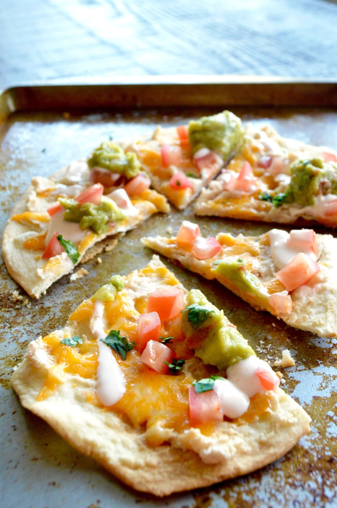 Healthy Tortilla White Bean Pizza cut on a tray ready for immediate serving!