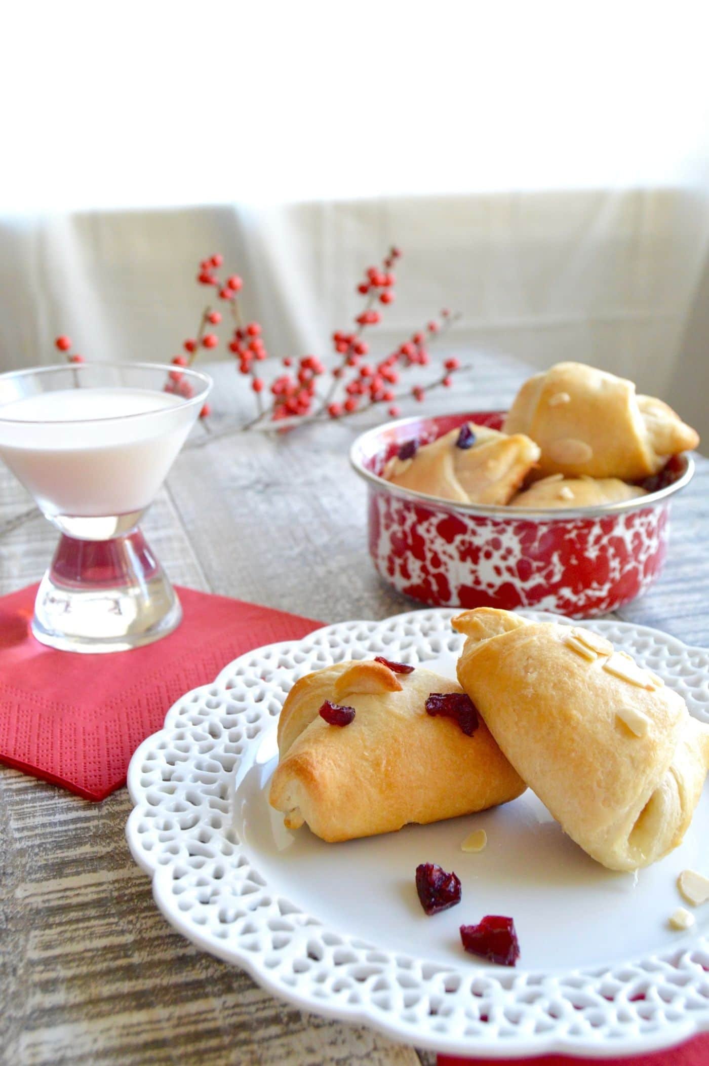 Party Brie Cheese Crescent Bites are ready in no time! Filled with Melty brie cheese, tart cranberries or nuts, baked in flaky pastry then drizzled with a bit of sweet sticky honey! These are perfect for last minute gatherings!