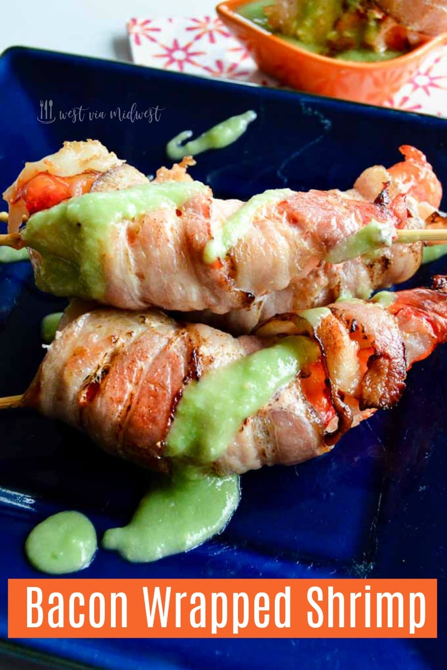 skewers of shrimp wrapped in bacon on a plate.