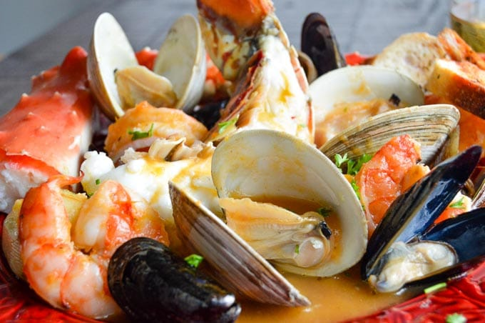 Fancy Bouillabaisse is full of shrimp, lobster, crab in a light flavorful healthy broth perfect for a great meal to serve company!  A fish stew ready in less than 45 minutes!