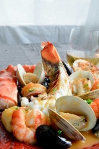 Seafood stew that is full of crab, shrimp and lobster for entertaining