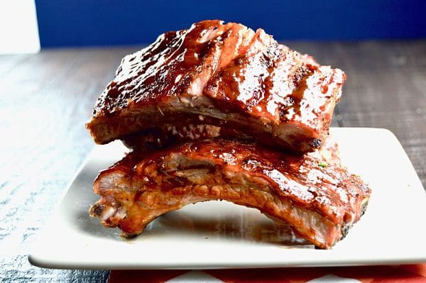 Grilled low and slow yields fall off the bone tender BBQ ribs, brush with a tangy bbq sauce for lip smacking deliciousness. Perfect for summertime entertaining!