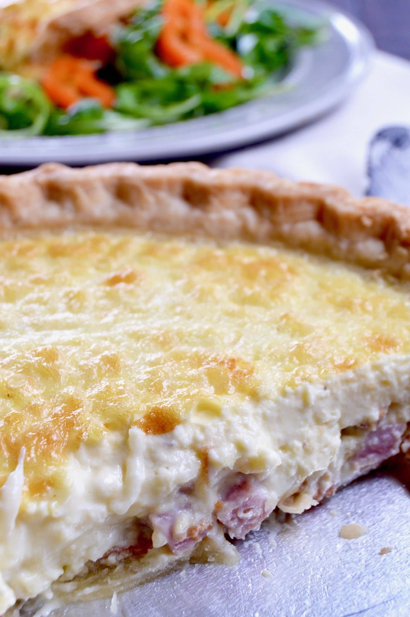 No Fail Quiche Lorraine (shown here with the stand up custard), an easy yet impressive recipe full of melty cheese, crisped bacon and ham mixed in a light creamy custard in a flaky buttery crust.