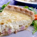 No Fail Quiche Lorraine, an easy yet impressive recipe full of melty cheese, crisped bacon and ham mixed in a light creamy custard in a flaky buttery crust.