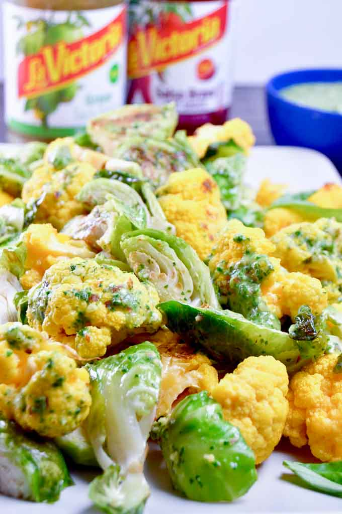 cauliflower and sprouts coated in green chile salsa verde pistou