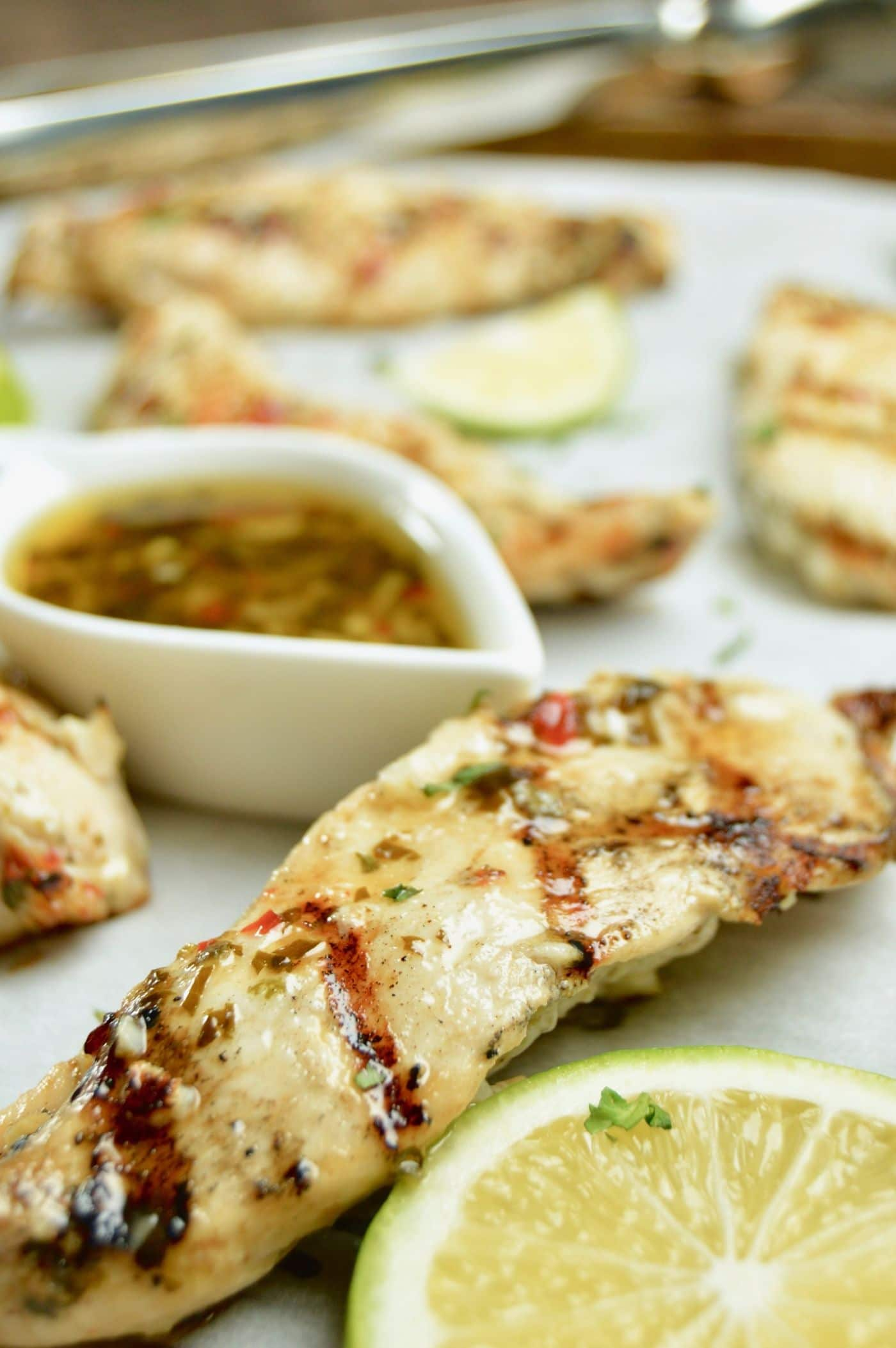 Tray of tender juicy Chili Lime chicken with a sauce to dip into!