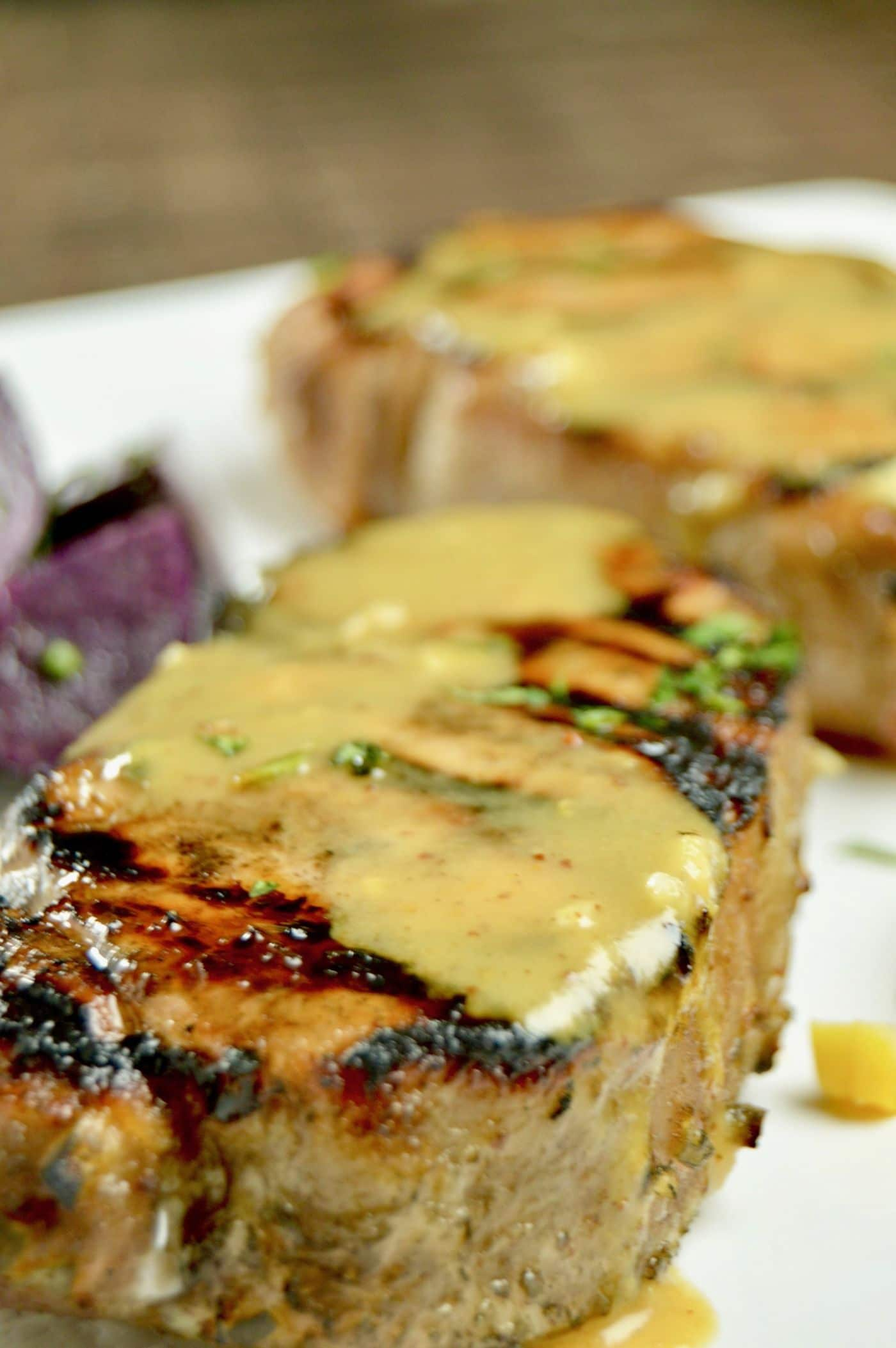 Juicy Grilled Honey Mustard Glazed Pork Chops is the no fail way to make succulent, tender chops. Marinate for 30 minutes, grill and have them on the table in about 15 minutes.