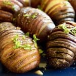 Grilled Hasselback Potatoes are ideal for entertaining. Easy to prep ahead, crunchy on the edges, lightweight centers drenched with bourbon garlic butter for lots of flavor!