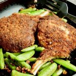 Parmesan Crusted Pork Chops are an ideal meal for easy weeknight entertaining. Panko laced with tangy parmesan, crunchy outside crust over succulent tender pork chops.