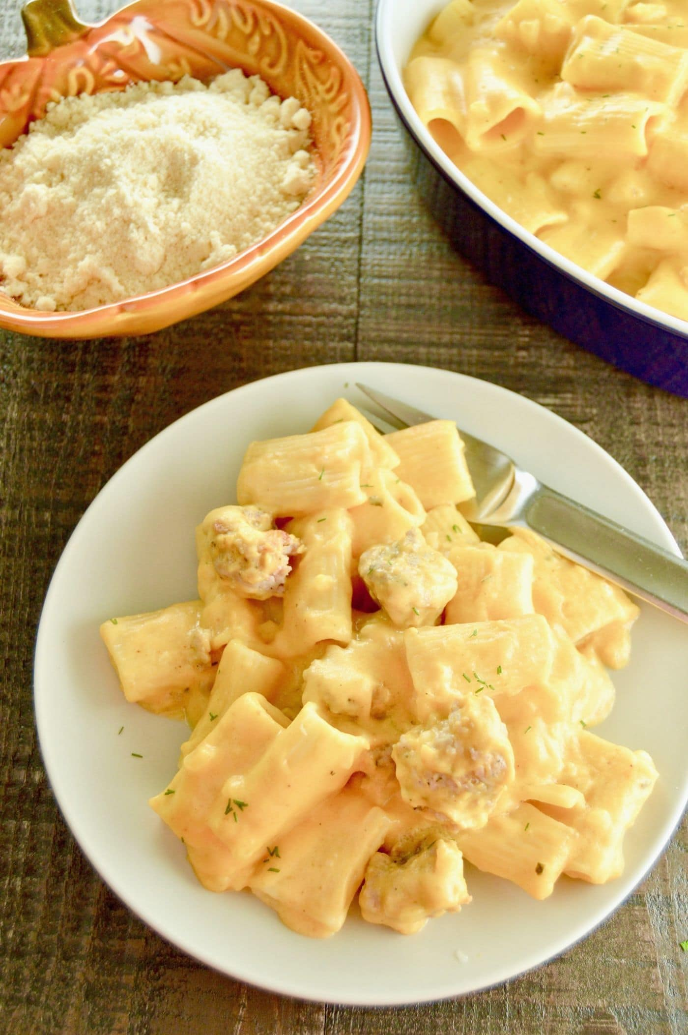 Pumpkin Pasta with Italian Sausage is velvety, cheesy, with hints of earthy pumpkin to lighten the sauce from your regular Mac n Cheese.  A simple weeknight dinner choice for entertaining on a work night.