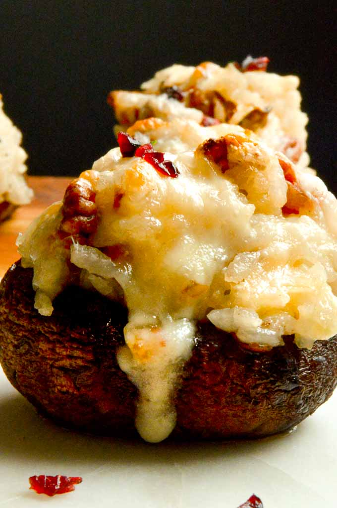 Perfectly melted cheese and rice in stuffed mushrooms