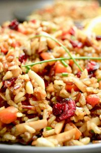 close up of moist, moroccan rice pilaf with carrots, almonds and cranberries