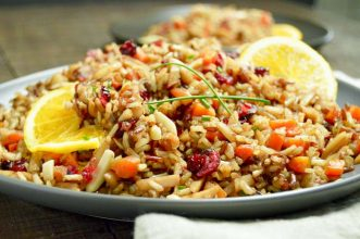 Rice Pilaf with fall harvest flavors ion a grey plate