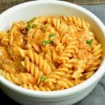 Warm and comfort food bowl of Cheesy Taco Goulash Pasta is a twist on a family staple. Cheesy, Spicy, warm comfort food with pantry staples that you can make last minute for spur of the moment entertaining!