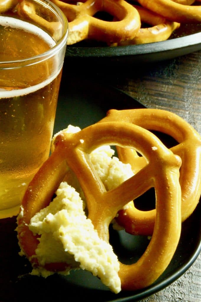 Close up of Spreadable Pub style cheese dip on a pretzel