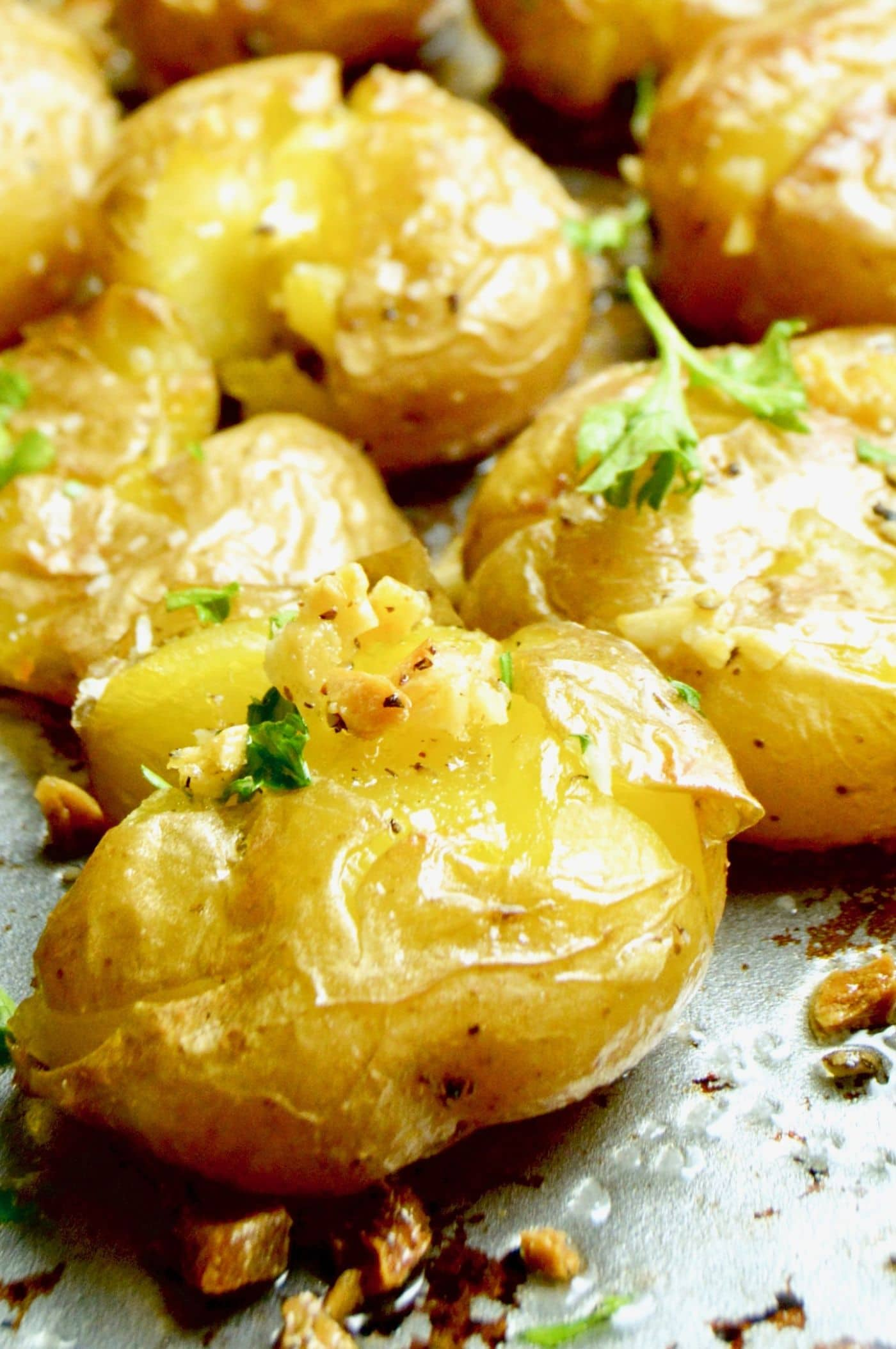 Smashed Lemon Garlic potatoes crusty crunchy on the outside, creamy inside bursting with fresh herb flavors.  A show stopping potato side dish for entertaining!