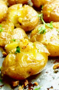 smashed potatoe with crunchy garlic on a tray