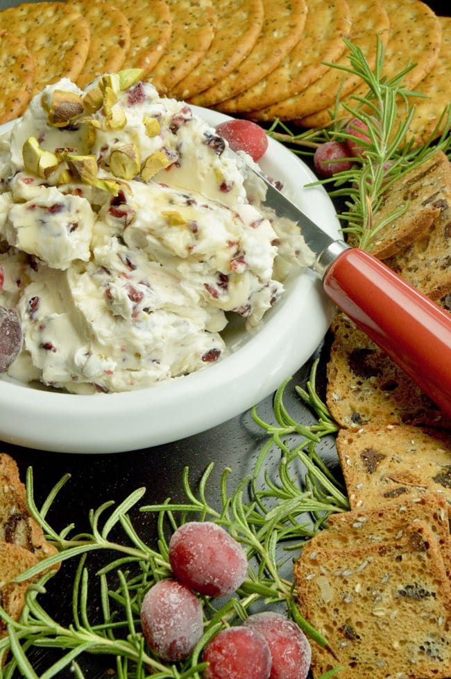 Full of tangy cream cheese accented with tart orange, sweet cranberries this festive Cranberry Orange Cream Cheese Dip for Crackers is perfect for all of your holiday parties, from happy hour to watching the big games!