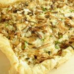 Close up of a French onion Tart made on puff pastry