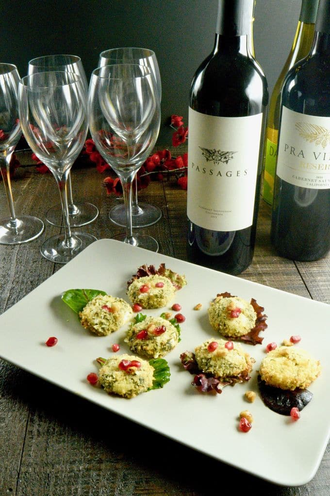 Warm Goat Cheese discs served alone instead of in a salad with all the wine bottles and glasses for serving at a party.