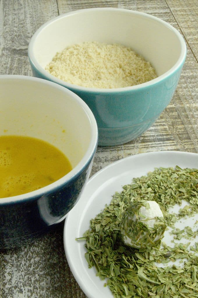 Warm Goat Cheese Salad| Making the dipping stations to coat in herbs, egg wash then panko.