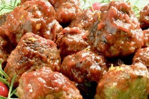 Close up of Cranberry Meatballs on a platter for serving at a party.