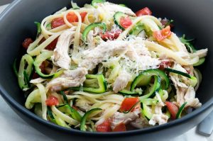 Bruschetta Chicken Zucchini Spaghetti has the pasta you are craving but lightened up with zucchini noodles.  Flavored with fresh tomatoes and roasted chicken that fits the healthy comfort food you are craving!