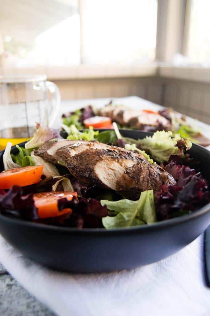 Chicken seasoned with jerk seasoning in a grilled jerk chicken salad