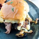 Grilled tangy onions and melty cheese top these easy to make Roast Beef Sliders for any game day party that will have everyone coming back for more!