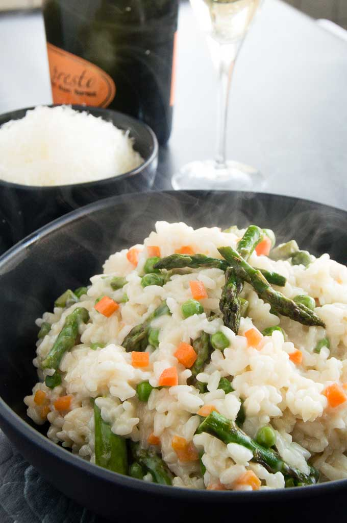 Fresh Vegetable Risotto on a black plate